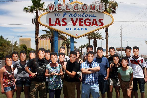 Mask-arade Elvis masks being warn by a group of people in Las Vegas