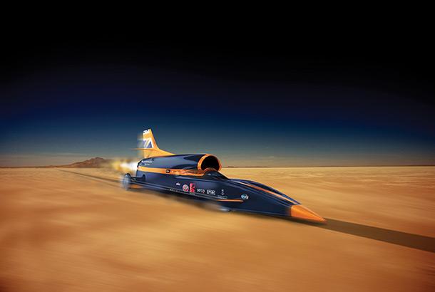 The Bloodhound car speeding across a barren landscape
