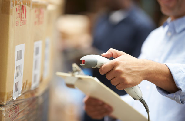 Image of warehouse employee scanning a barcode.