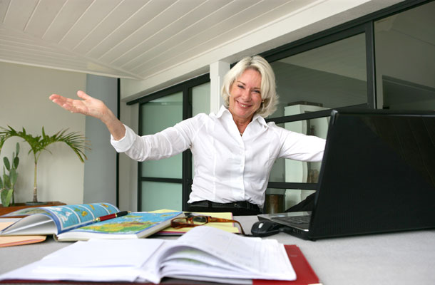 Image of business woman sat at her desk.