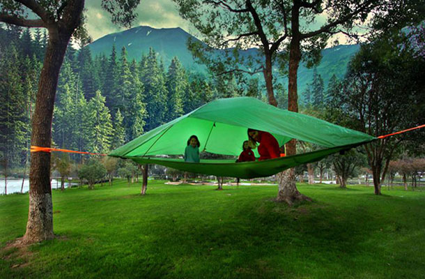 Image of a family within a Tentsile in the forest.