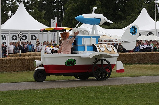Photo of man dressed as Pat Pending driving a boat car
