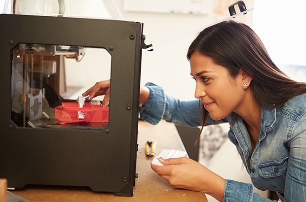 Image of a female using a 3D printer.