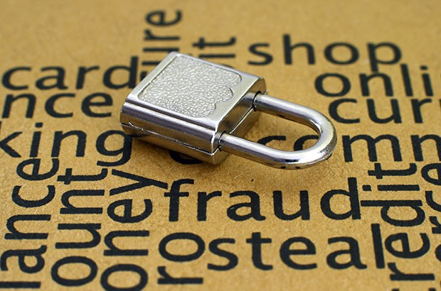 Image of a padlock against words such as fraud and secure.