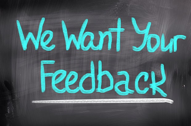 We want your feedback writing on a chalkboard.