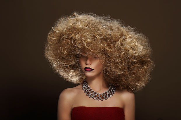Image of a fashion model with a big curly hair style.