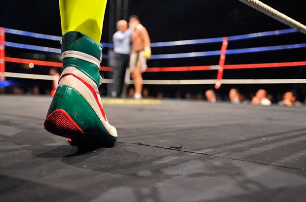 Image of a boxing ring and boxers feet.