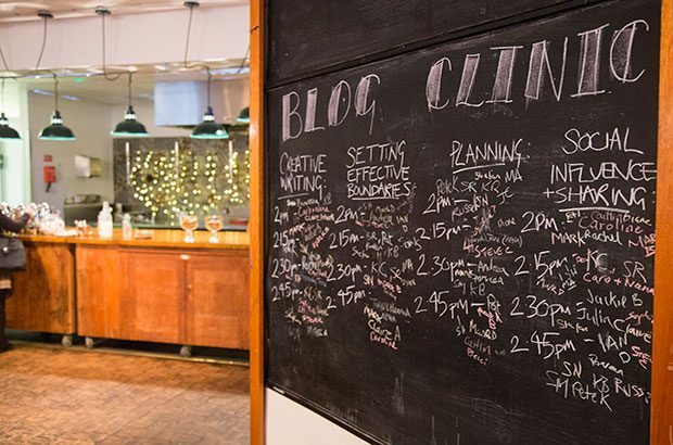 Image of white board with blogging clinics listed.