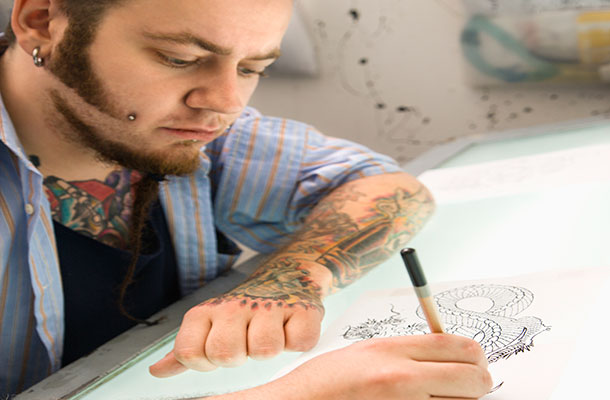 Image of tattoo artist drawing.