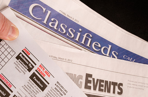 Image of classified ads in the paper.
