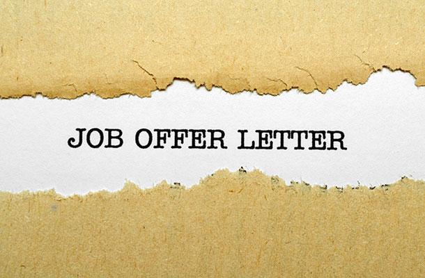 Job offer letter text on a pretend envelope.