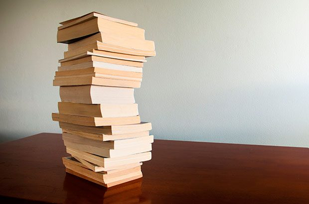 Stack of books on a desktop.
