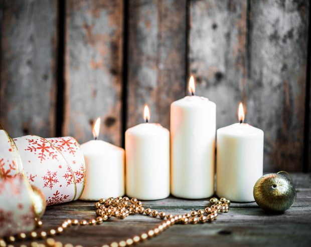 Christmas decorations with candles on wooden background