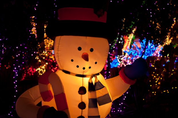 illuminated inflatable snow man with Christmas lights