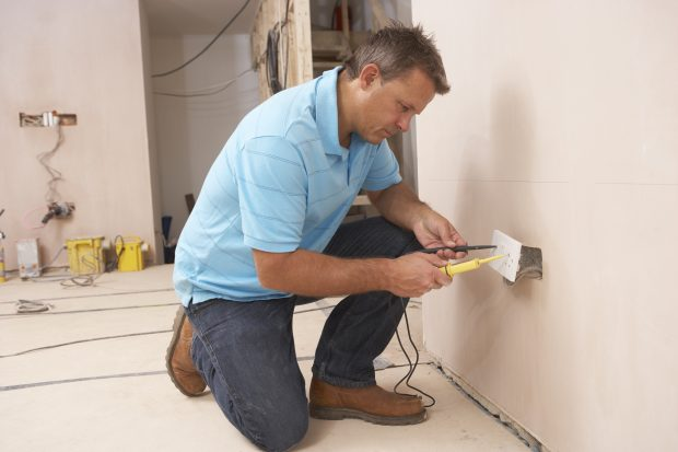 Electrician Installing Wall Socket