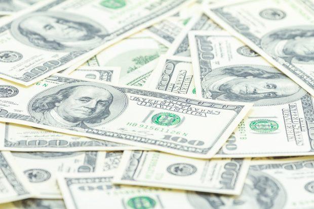 Bills one hundred dollars on white background.