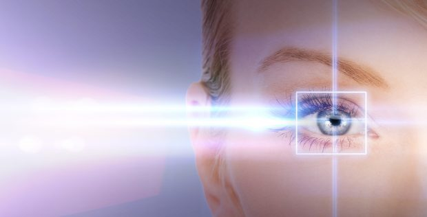 health, vision, sight - woman eye with laser correction frame