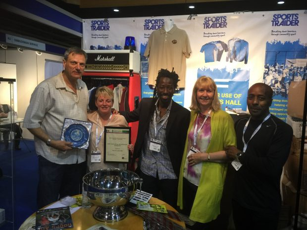 Lance and the Sports Traider team winning an award