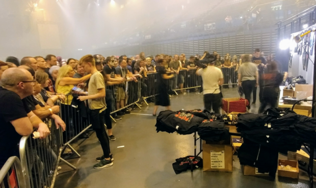 Fans queuing to purchase merchandise at a KISS concert