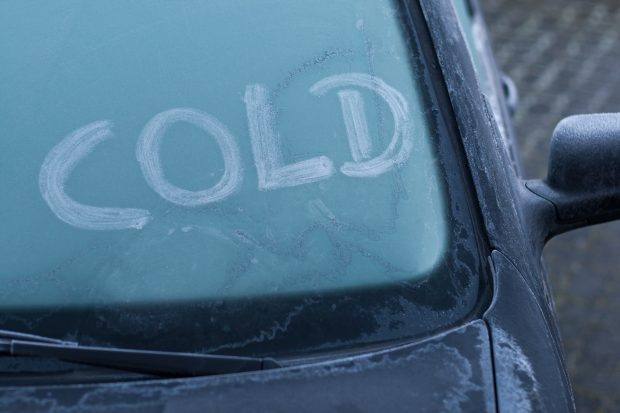 Frost on car with the word cold written on the windscreen