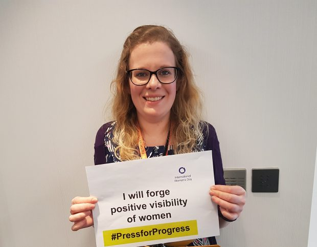 Georgina Menzies holding a pledge sign