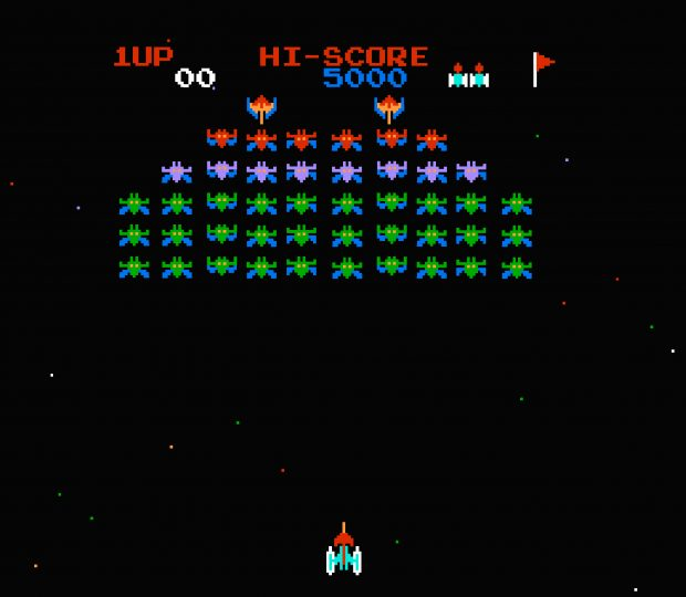 old arcade game showing a spaceship shooting alien ships