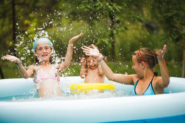 Girls splashing in swimming pool