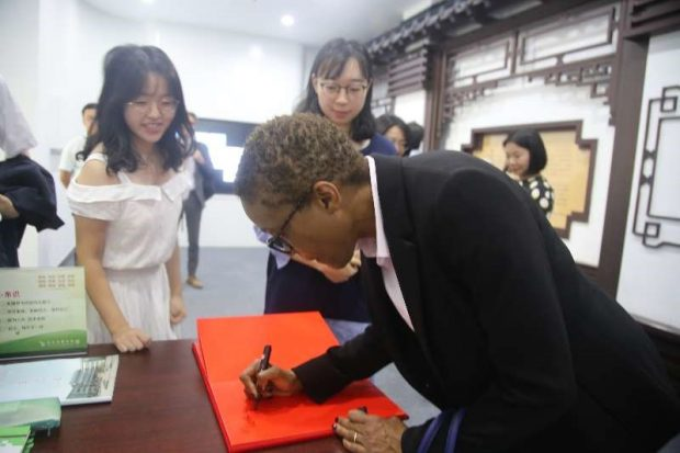 Signing museum visitors book at Zhongnan University of Economics and Law