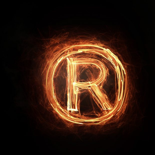 Glowing fire copyright sign on dark background