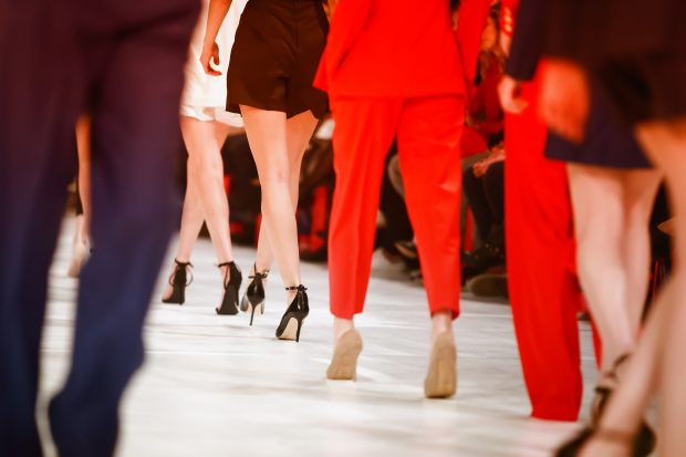 Models walking down runway
