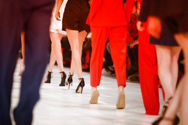 Models walking down runway