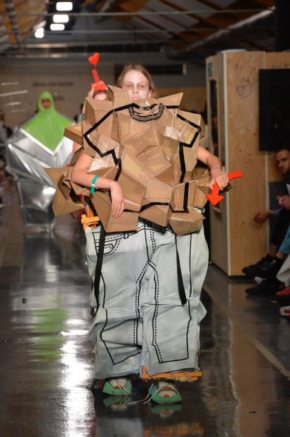 Model on catwalk wearing unusual outfit designed by Matilda Söderberg