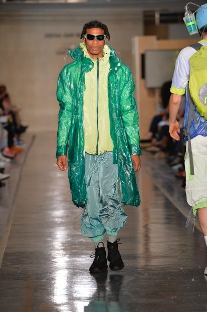 Male model on catwalk wearing colourful outfit designed by Randa Kherba