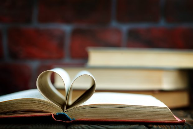 A book with pages folded to make a heart
