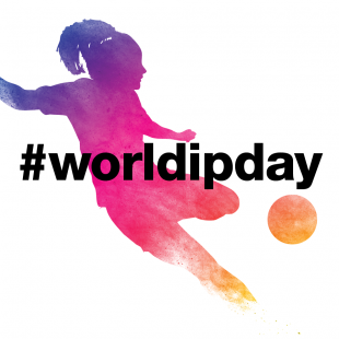 Shadow of woman kicking a ball with the hashtag worldipday