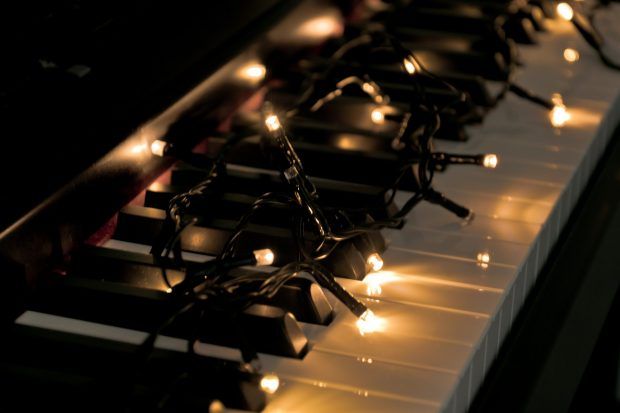 fairy lights on a piano keyboard