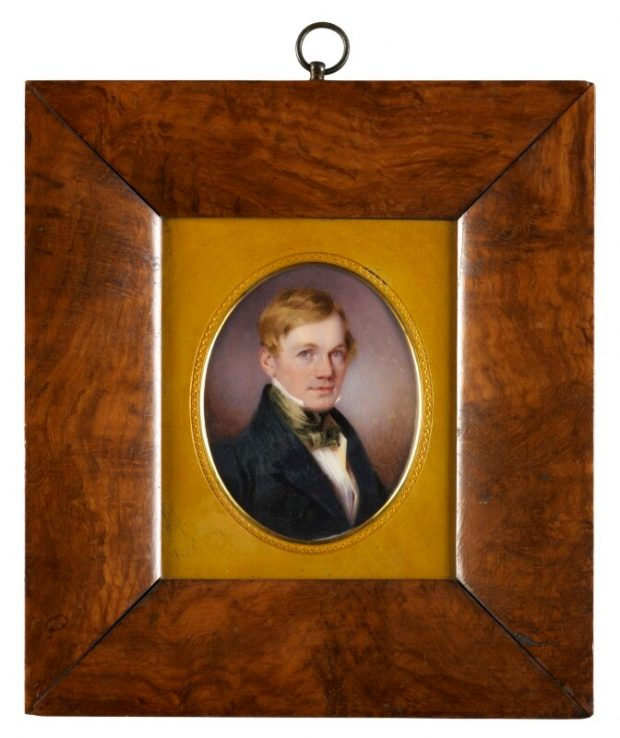 A portrait of Bennet Woodcroft in a wooden frame with yellow insert